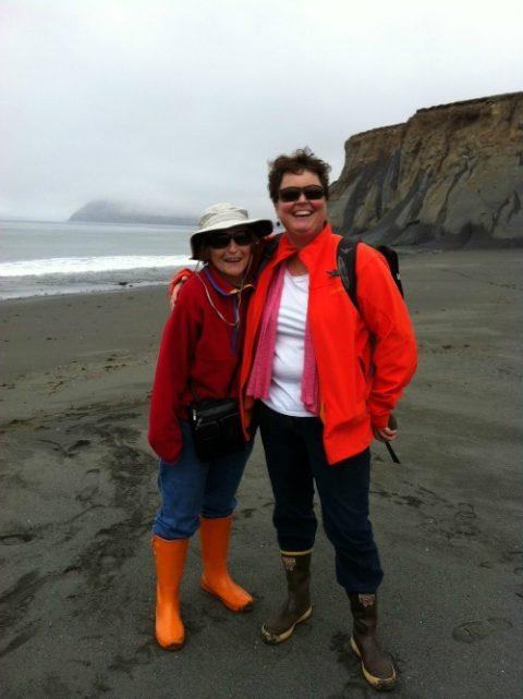 Vicki Clark on a Kodiak beach with Legal Director Valerie Brown mother.