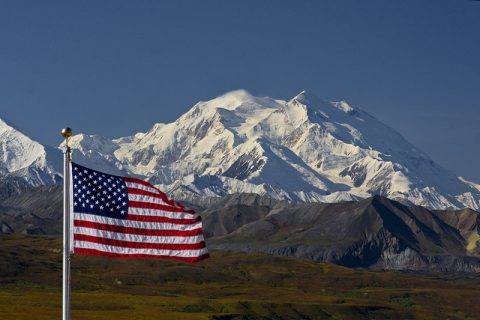 The National Parks are America's best idea. The iconic Denali with our flag. NPS photo by Ken Conger.
