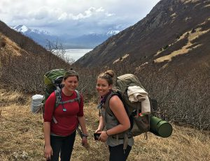 Hannah with friend with backpacks in mountains