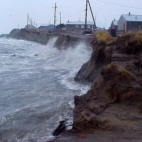 Photos of waves watching against an eroding wall of dirt with house precariously close to the edge.