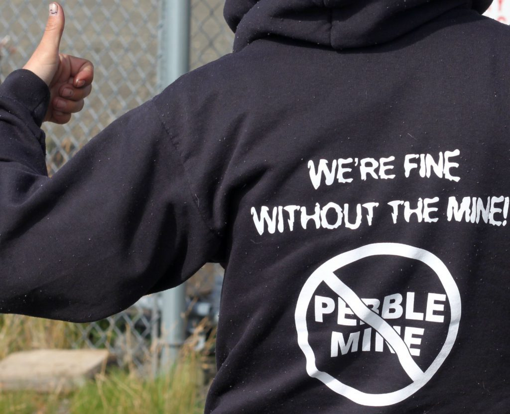 "Shot of sweatshirt that says, ""We're fine without the mine"" and a slash through Pebble mine."