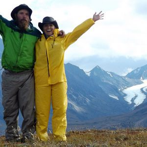 Michelle and partner Ranger B wave from a ridge in Denali National Park. A bittersweet farewell.