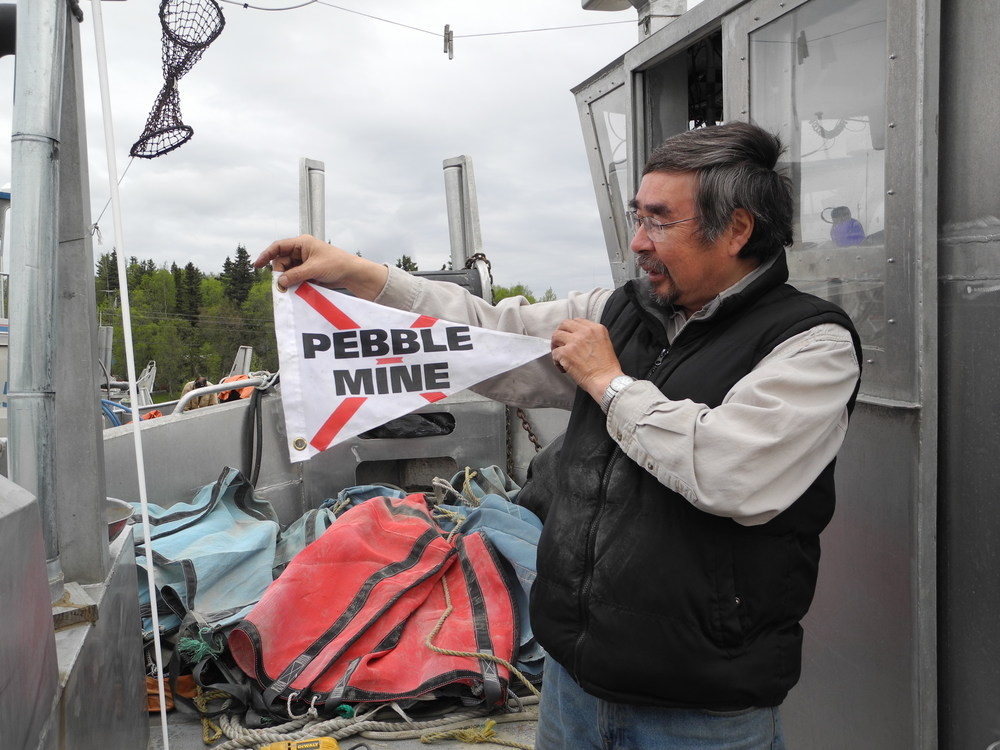 Chief Tom Tilden holding a no Pebble mine flag.