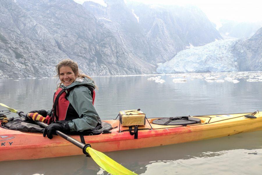 Rachel in a kayak in front of a glacier in Kenai Fjords.
