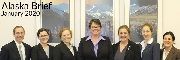 A formal photo of our legal team, but change is coming and staff transitions are underway.